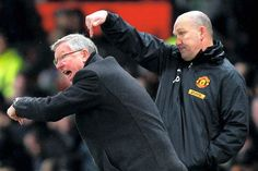 Sir Alex Ferguson and Mike Phelan instruct the team in 2013