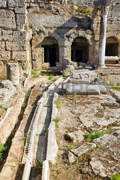 Picture of Viaduct and ruins in Corinth, Greece - archaeology background stock photo, images and stock photography. Ancient Ruins, Ancient History, Corinth Greece, Somewhere In Time, Mystery Of History, Image Photography, Abandoned Places, Archaeology, Egypt