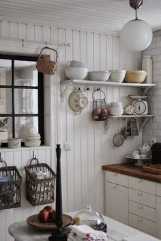 white kitchen butcher block counters open shelving