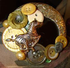 Buttons and Bling brooch made from large hoop earring and mirror