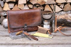 A very rare offer: a Swiss Army tool bag from the 1950s, made from beautiful brown saddle leather, filled with original contents. The previous owner of this bag told us that it belonged to his uncle, who in the late 1970s was an explosives expert, responsible for wiring Swiss bridges with explosives. During the Cold War, the Swiss Army rigged bridges and tunnels across Switzerland with explosives, ready to be detonated in case of a Soviet invasion and halt enemy tanks. Macbook Air Laptop, Laptop Bag, Saddle Leather, Leather Bags, Swiss Army Bag, Cold War, Laptop Computers, Leather Design, Vintage Leather