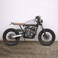This looks like no fun at all . Killer Honda XR600 street tracker with a front…