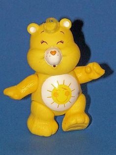 """Care Bears! ~ The bears made their debut in a line of greeting cards & soon graduated into a rainbow of 12-in. plush toys. Each was embellished with a unique symbol on its tummy, an emotional identifier to potential playmates. Bear feelings ranged from """"Funshine"""" to """"Grumpy,"""" and just in case an impostor would sneak into the group, each bear had a hard plastic heart stuck on its tiny tush."""