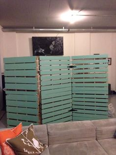 DIY pallet wooden room divider is shown in the picture which has an amazing look and looks gorgeous, See in the picture that behind this another room divider is placed which is small in size with respect to first but both have same look in watching.