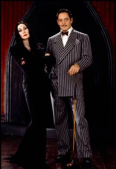 """Anjelica Huston and Raul Julia as """"Morticia"""" and """"Gomez Addams"""" in The Addams Family. Anjelica Huston and Raul Julia as Morticia and Gomez Addams in The Addams Family. Adams Family Kostüm, The Addams Family, Addams Family Costumes, Gomez Addams Family, Group Costumes, Morticia Addams Kostüm, Morticia Adams, Gomez And Morticia, Morticia And Gomez Costumes"""