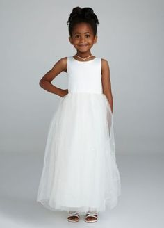 Your flower girl is sure to feel like a little princess in this gorgeous tulle dress.  This stunning sleeveless satin bodice dress is perfect for any special flower girl.  Full tulle skirt features sensational beading for a touch of sparkle.  Available in select stores. Not available for special order.  For a splash of color, wear it with Sash S1041, sold separately.  Fully lined. Back zip. Imported polyester. Dry clean.