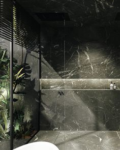 Black marble bathroom facing a patio with a tropical touch. By Dieter Vander Velpen Architects. / marble by Il Granito
