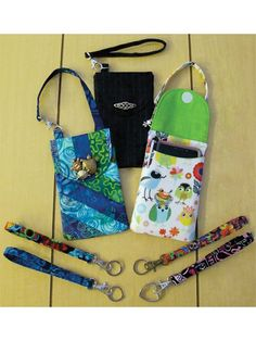 """Includes full-sized pattern pieces and instructions to make a wristlet phone fob, wristlet key fob and a phone fob pocket with a strap to hook to your purse or backpack. Finished size of the phone pocket is 3 3/4"""" x 5 7/8"""" with instructions..."""