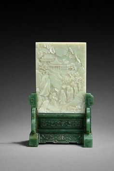 A carved jade table screen with nephrite stand (Qing Dynasty period)