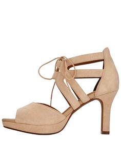 Clarks Mayra Ellie Heeled Sandals - Nude Dance all night dates are made unbelievably comfy with the MayraEllie heeled sandals by Clarks! The supersoft sockliner and platform sole make them dreamy to wear and lend a luxe feel underfoot, while nude hue is complemented by a suede upper and ghillietie fastenings. A peep toe flaunts your perfect pedicure, and the slick heel elevates your look.Team with a swish-worthy dress, statement accessories and a sweep of dark lipstick for your next…