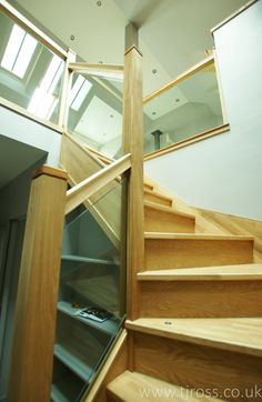 Oak and Glass staircase with under stair storage and Skylights above