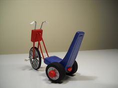 Danny's Trike.  Fimo, wire and wood wheels.  That was a challenge.  No, the wheels do not turn!