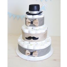Mustache Diaper Cake for Baby Boy / Little Man Baby Shower Centerpiece Decoration Unique Gift / Black hat gentle man / Nursery Decor Bowtie by AngAngBabyUS on Etsy https://www.etsy.com/ca/listing/271802684/mustache-diaper-cake-for-baby-boy-little