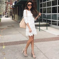 White dress with cut away detailing. Matched with strapy nude sandals.