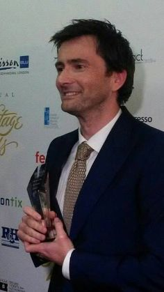 Just pinning all of these pics of DT and his award just because ^_^