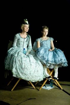 Alice in Wonderland (2010) by Tim Burton. Mia Wasikowska as Alice Kingsleigh and Lindsay Duncan as Helen Kingsleigh. Costume design: Colleen Atwood.