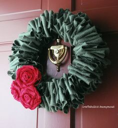 Love this DIY green and red burlap Christmas Wreath! So easy to make and looks stunning. A great Christmas craft for all skill levels