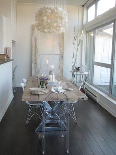 love the light, chandelier, and chair combination in this dining area. also the mix of glam with the rustic table.