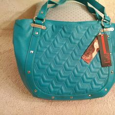 """Sofia Vergara tote/shoulder bag Great bag! a gorgeous dark turquoise color with silver metal studs and quilted design on front; large size 17"""" wide x 12"""" tall; new with tags Bags Totes"""