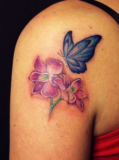 Flower with Butterfly Tattoo ... DEF different flowers though