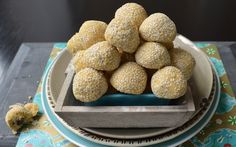 These fat little marbles are my variation of the classic ghraiba cookie from Tunisia. Dates and sesame are ingredients that are used a lot in Tunisian baking. So I kneaded some sesame seeds through the dough, filled the cookies with finely chopped dates and rolled them through some extra sesame seed. I like the crunch the sesame seeds give the dough.