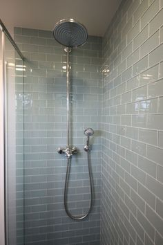 Blue glass subway tile for the shower. Simple and Spa like.