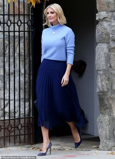 Ivanka, was seen leaving her Washington, D. home on Thursday morning wearing a cornflower blue mock-turtleneck sweater tucked into a navy pleated skirt. Ivanka Trump Outfits, Ivanka Trump Style, Ivanka Trump Dress, Work Fashion, Modest Fashion, Skirt Fashion, Fashion Outfits, Womens Fashion, Casual Work Dresses