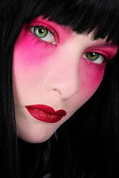 This is very Japanese to me and is just stunning. It makes it look like she has a face made of porcelain. The contrast between the pink and the green of her eyes is bold.