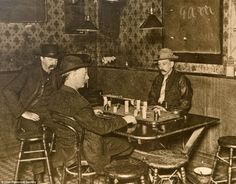 gamblers enjoying a game at the Faro table at the White Elephant Saloon in Bingham, Utah, 1906   wallpaper, lamps, chairs