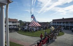 FORT MCHENRY (Sept. 14, 2014) A 30-foot by 42-foot Star Spangled Banner Flag replica is raised during the By Dawn's Early Light program at Fort McHenry in support of the Star Spangled Spectacular. The event celebrated the bicentennial of the Battle of Baltimore, which provided the inspiration for the Francis Scott Key poem, Defense of Fort McHenry, which later became America's national anthem. (USN Mass Comm Spec 2nd Class Lacordrick Wilson)Note former opposition British Royal Navy at left.