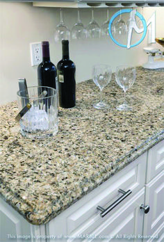 Excellent venetian gold granite with off white cabinets just on homeeideas.com