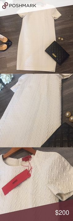 """NWT HUGO BOSS Dress, Size 0 Gorgeous classy and sophisticated HUGO BOSS dress in the perfect ivory shade and textured fabric. BRAND NEW with attached tags. Measures approx 35"""" in length; fully lined. Ask any questions! Hugo Boss Dresses"""