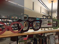 Oversized eyeglasses cut from foam core and embellished with decorative paper.for our Your Personal Librarian display. Library Book Displays, Library Books, Optometry Office, Decorative Paper, Delta Gamma, Paper Decorations, Board Ideas, Bulletin Boards, Industrial Design
