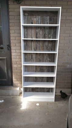 I redid this bookcase by taking off the  backing that was already on it and replacing with old wood from a fence my neighbors just took down. I love how it turned out.