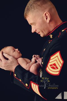 Newborn Boy with Dad in Marine dress blues.  Military Uniform.  Military newborn photography