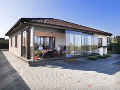 Retractable terrace enclosure CORSO is ideal to cover seating set or hot tub.