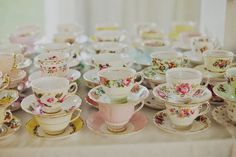 Tea cup favors'! i would add little succulent plants and flags that say Love is Beau-Tea-ful!  And the wedding date on the back with groom and bride names
