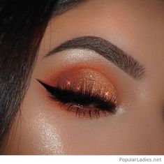 Orange eye makeup with glitter