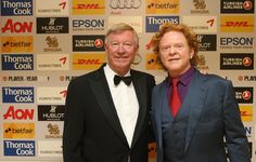 Sir Alex Ferguson poses with Simply Red frontman Mick Hucknall before the 2011 Player of the Year dinner at Old Trafford. The Mancunian frontman is a passionate @manutd fan and named his band in reference to his flaming red hair and his love of United.