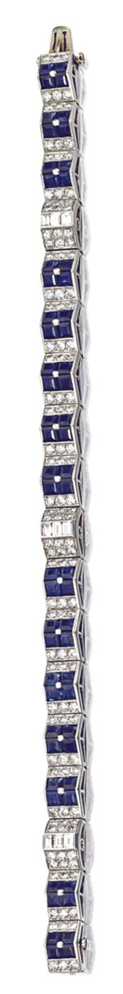SAPPHIRE AND DIAMOND BRACELET, CARTIER, NEW YORK, CIRCA 1935.  Designed as a series of links decorated with squares of calibré-cut sapphires, interrupted by three links set with trios of baguette diamonds, all within round diamond borders, the whole set with 9 baguette and 126 round diamonds weighing approximately 3.00 carats, mounted in platinum, length 7 inches, signed Cartier.