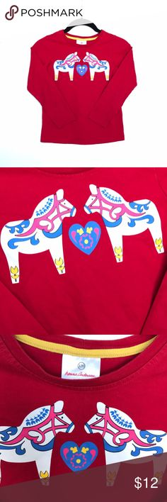 Hanna Andersson NWOT red long sleeve tee from Hanna Andersson. Size 120cm/US 7. Features 2 carousel horse appliqué on front.  No tears, holes, stains, fading or defects. Thanks for stopping by!! As always, all items are from a smoke-free and pet-free home  Thanks for shopping Reclaimed Treasure Resale ❤️ Hanna Andersson Shirts & Tops Tees - Long Sleeve