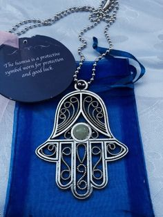A personal favorite from my Etsy shop https://www.etsy.com/listing/245283764/large-hamsa-necklace-pendant-protection