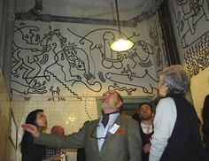 Photo showing portion of the mural Keith Haring painted in the men's room of the LGBT Community Center in NYC.  The old bathrooms have been re-purposed as meeting rooms.  :)