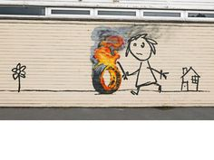LUV this news story... Street artist leaves a burning tire as present for school children