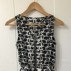 Mini summer dress in pattern Dark navy and white pattern with zipper going through bottom to top. Perfect for summer Dresses