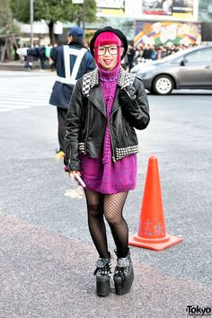 Haruka is an aspiring Japanese comedian/entertainer who sometimes appears in Kera Magazine. When we spotted her in #Shibuya, Haruka's look included pink hair, a Candy Stripper beret, a studded leather jacket & platform sneakers from Glad News, a Jouetie knit dress & a Furby! Her full look, with closeups, is here. #tokyofashion   #streetsnap