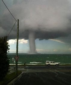 Water Spout with a storm offshore as a car races on ahead as the waterspout appears close to the shoreline at Batemans Bay, 225 km south of Sydney All Nature, Science And Nature, Amazing Nature, Tornados, Thunderstorms, Severe Weather, Extreme Weather, Tsunami, Natural Phenomena