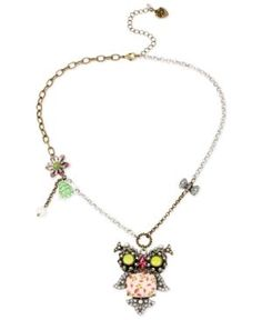 Betsey Johnson Tri-Tone Owl and Multi-Charm Pendant Necklace (885043915029) A wise addition to your jewelry collection. Betsey Johnson's playful pendant necklace features a tri-tone setting that's accented with a dangling owl, crystal-embellished bow, and flower and bug charms. Crafted in gold-tone, silver-tone and hematite-tone mixed metal. Approximate length: 18 inches + 3-inch extender. Approximate drop: 2-1/4 inches.