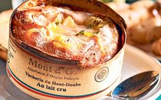 Baked vacherin mont d'or, served warm fondu-style with potatoes, ham and   cornichons to dip into the rich, tangy cheese.