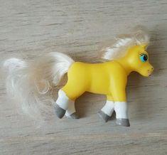 Yellow palomino magazine pony